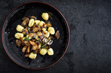 Prepared mushrooms and gnocchi dish served in the plate,blank space and selective focus - 218864843
