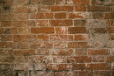 Old brick wall and plaster