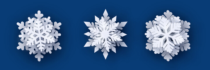 Vector set of 3 white Christmas paper cut 3d snowflakes with shadow on dark blue background. New year and Christmas design elements © Oksana Kumer