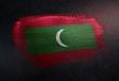 Maldives Flag Made of Metallic Brush Paint on Grunge Dark Wall