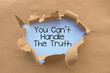 You can't handle the truth saying behind torn brown paper or cardboard