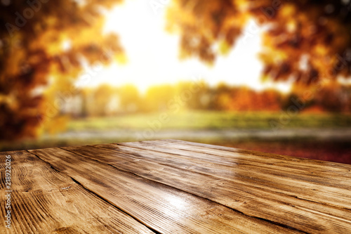 Table background and autumn landscape