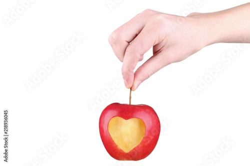 Female Hands Holding Red Apple With Cutout Heart Shape On