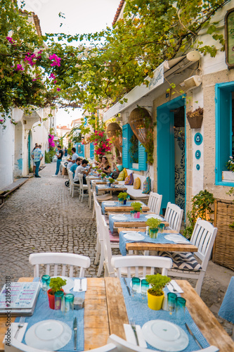 Streets of Alacati Turke with cozy colorful restaurants