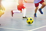Children playing soccer indoors - 218975406