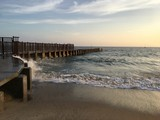 Waves crash against a jetty in Playa Del Rey, California, at sunset.