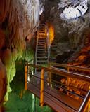 stairway in underground semi submersed cave