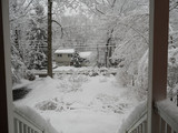 looking from the porch during a snowfall - 219024497