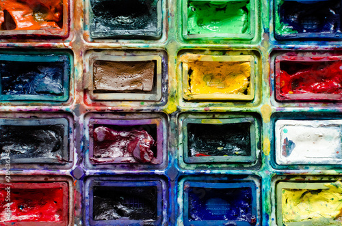 Artist paint brushes and watercolor paintbox © Nelly Kovalchuk