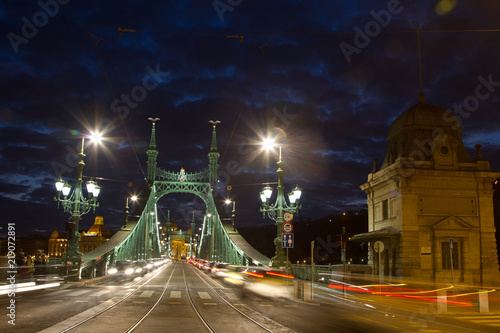 Liberty Bridge in Budapest Hungary at night with a nice cloudy sky