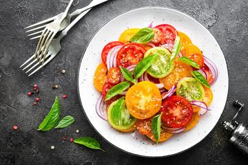 Tomato salad. Fresh vegetable salad with tomatoes, onion and basil © Sea Wave