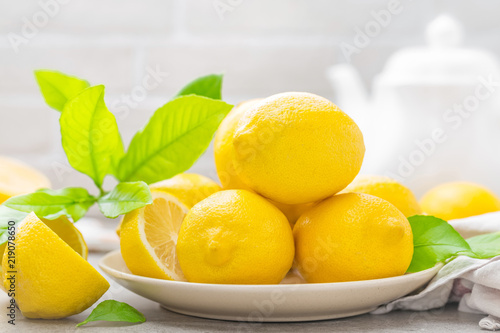 Fresh lemons with lemon leaves - 219078650