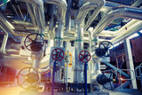 Equipment, cables and piping as found inside of a modern industrial power plant. Industrial zone, Steel pipelines, valves, cables and walkways - 219092225