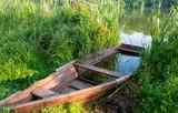 old boat on river - 219092439