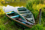 wooden boats on summer river - 219092440