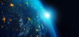 Earth from space at night with city lights and blue sunrise on stars background. 3d rendering. Elements of this image furnished by NASA. - 219100607