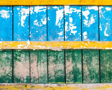 Grungy blue, green and yellow wood wall texture, torn paper in the top half - 219122891