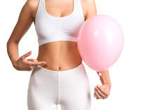 Woman Holding A Balloon Feeling Bloated Concept   Sticker