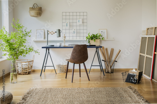 Real Photo Of Bright Home Office Interior With Carpet, Leather Chair By The  Desk And