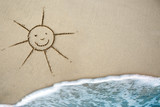 Sun drawing in the sand at the caribbean beach.