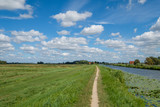 Panorama view, cloudy blue sky above a polder. - 219131256
