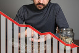 Bearded man counting money and graph down - 219148856