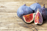Figs are Fresh ripe whole and cut into a wooden old background. copy space - 219150620