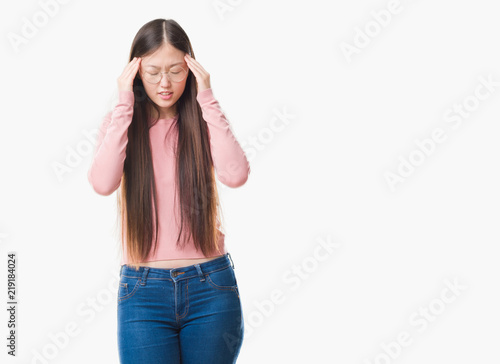 0c38309836b Young Chinese woman over isolated background wearing glasses with hand on  head for pain in head