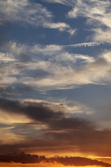 Beautiful colorful sky with clouds at sunset. Portrait composition used.