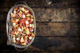 Prepared healthy salad with vegetables,baked bread and mozzarella served on the wooden background with blank space,selective focus - 219210833