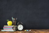 Back to School Concept with Stationery Supplies and Blackboard - 219221483