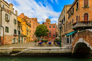 Weathered building facade on a picturesque square in Venice Italy