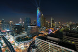 Night view with skyscraper in business district in Bangkok Thailand. Light show at Magnolias Ratchaprasong in Bangkok, Thailand. - 219240260