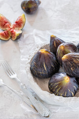 figs in bowl and rustic background. High key