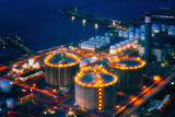 industrial factory at night with storage tanks - 219261489