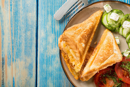 Fototapeta Sandwiches with cheese, tomatoes and cucumber.