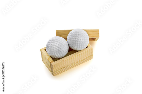 Golf balls in wooden boxes on a white background. - 219264053