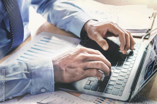Naklejka businessman using laptop working in office. concept finance and accounting