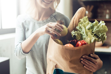 Closeup of Smiling Girl holds Bag of Healthy Food © VadimGuzhva