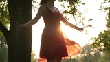 Happy girl dancing on green field, beautiful red dress, light dress fly in air - 219288609