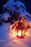 Christmas lantern in the woods under the tree. Lantern with a candle on Christmas eve. - 219292064