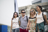 Tourist group friendship walking travel in the city - 219293426