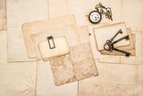 Vintage letters keys pocket watch Flat lay paper background - 219298037