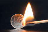 Symbol of inflation. Russian crisis: fall of rus rubles. Currency depreciation. Money concept. Сoins ruble sign and burning match on black background. - 219299429