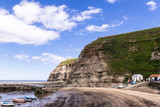 Staithes, North Yorkshire, UK.  A view of Staithes harbour and the Penny Nab headland. - 219324422