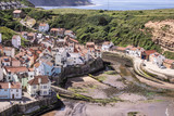 A view of the North Yorkshire UK villages of Staithes and Cowbar, seen here from from Penny Nab headland. - 219324831