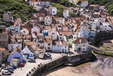 A view of the North Yorkshire UK village of Staithes, seen here from from Penny Nab headland. - 219324876