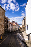 Staithes, North Yorkshire, UK.  A view looking down High Street towards the harbour. - 219324898
