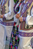 Detail of Romanian folk costume for women and men - 219327079