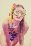Woman with snorkeling mask having fun - 219341238